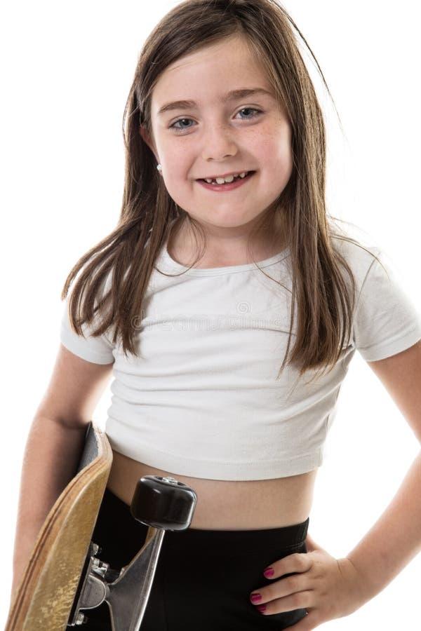 Chica joven fresca con el monopatín imágenes de archivo libres de regalías