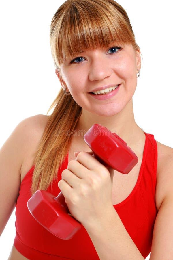 Chica joven hermosa que hace ejercicios de la aptitud. foto de archivo