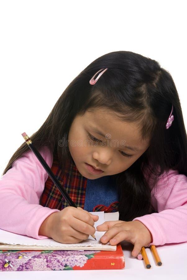 Chica joven que escribe 3 fotografía de archivo