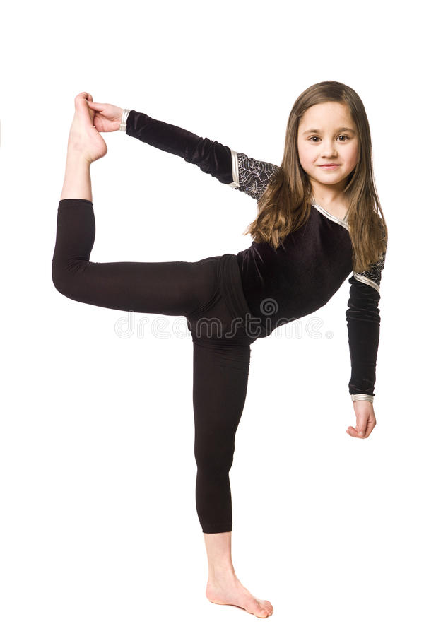 Chica joven que hace la gimnasia imagen de archivo libre de regalías