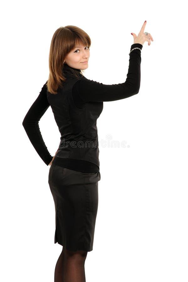 Chica joven que señala hacia arriba foto de archivo libre de regalías