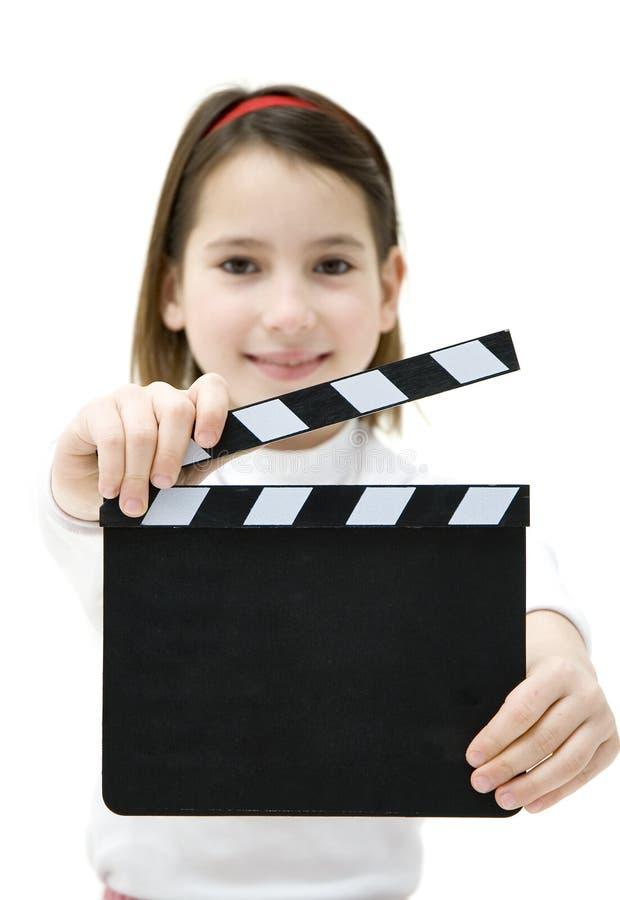 Chica joven que sostiene una chapaleta de la película imagenes de archivo
