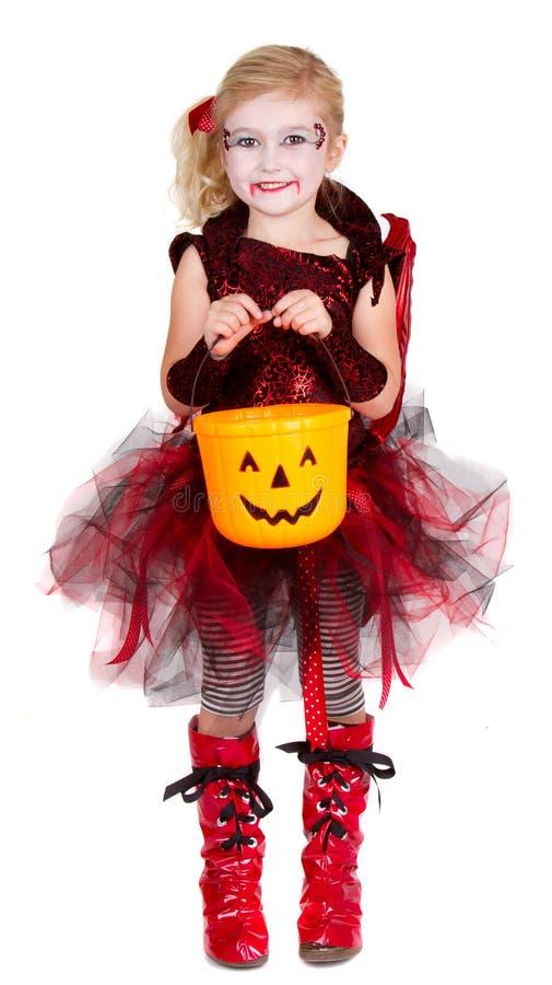 Chica joven vestida en el traje de Halloween fotografía de archivo