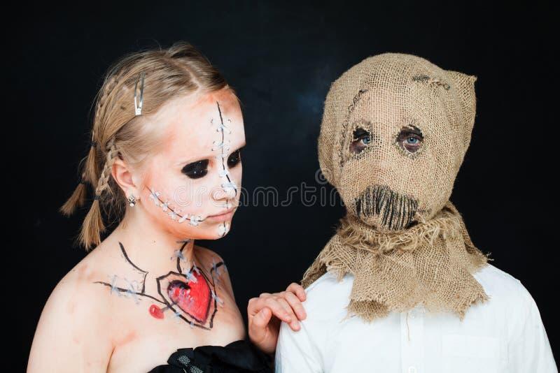 Chica joven y muchacho con maquillaje foto de archivo