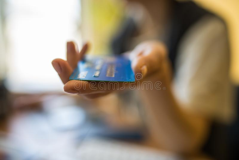 Chicago-April 23,2017:Woman's hand holding a Visa credit card for editorial use only. With blurred background stock photos