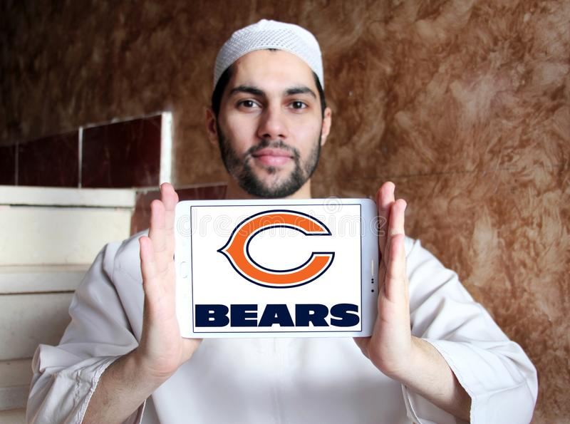 Chicago Bears american football team logo. Logo of Chicago Bears american football team on samsung tablet holded by arab muslim man. The Chicago Bears are a royalty free stock photos