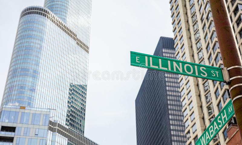 Chicago city skyscrapers, Illinois street and Wabash avenue crossing green signs. Chicago city downtown, Cityscape, spring day. Illinois street and Wabash avenue royalty free stock photography