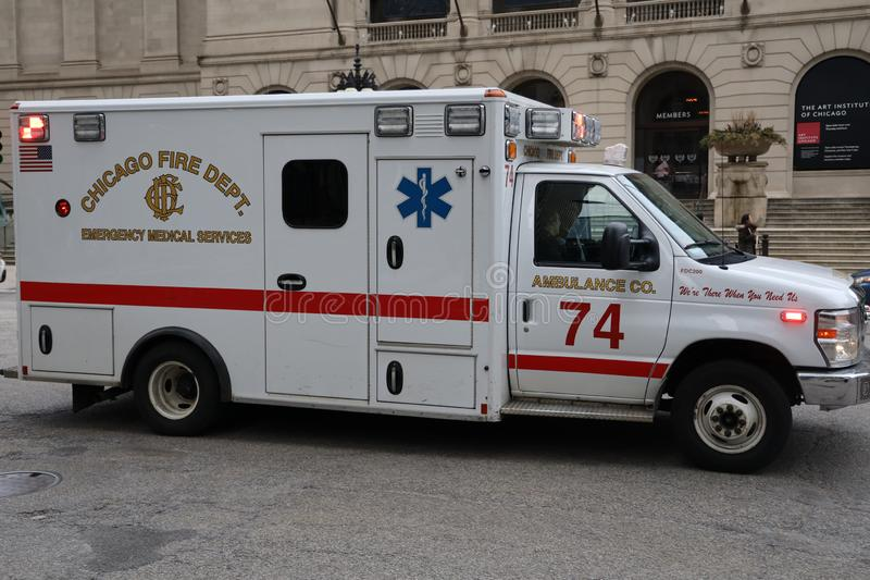 Chicago Fire Department Ambulance in Downtown. CHICAGO, ILLINOIS - MARCH 12, 2019: Chicago Fire Department Ambulance in Downtown. The Chicago Fire Department CFD stock photos