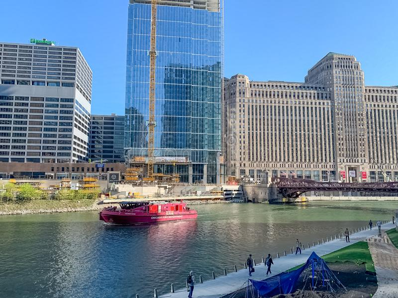 Chicago Fire Department boat near riverwalk with commuters and spring cleanup royalty free stock photos