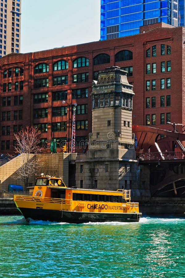 Morning over the Chicago River with view of LaSalle Street bridge as Water Taxi carrying commuters and tourists travels across the royalty free stock image