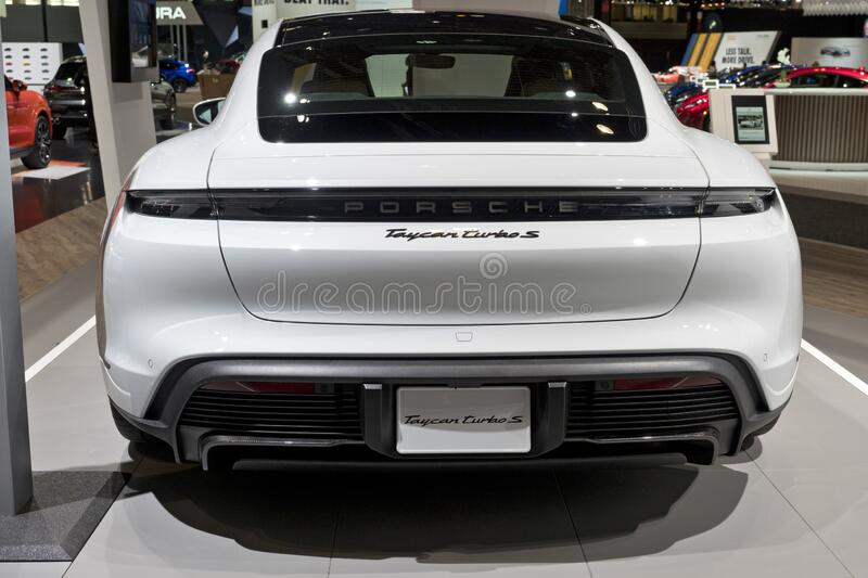 Porsche Taycan all-electric vehicle at the annual International Auto-show royalty free stock photo