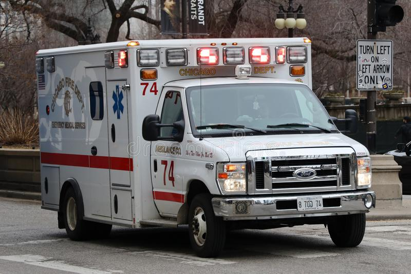 Chicago Fire Department Ambulance in Downtown. CHICAGO, ILLINOIS - MARCH 12, 2019: Chicago Fire Department Ambulance in Downtown. The Chicago Fire Department CFD stock photo