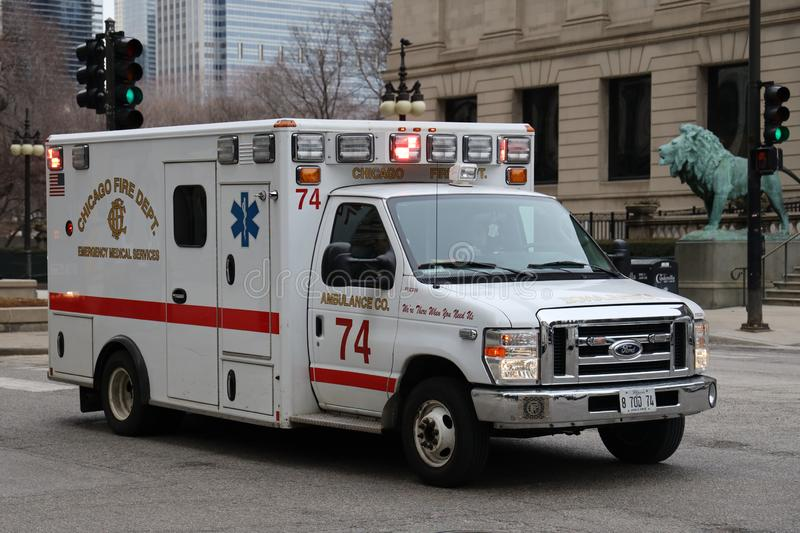 Chicago Fire Department Ambulance in Downtown. CHICAGO, ILLINOIS - MARCH 12, 2019: Chicago Fire Department Ambulance in Downtown. The Chicago Fire Department CFD royalty free stock photography