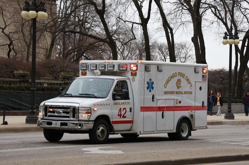 Chicago Fire Department Ambulance in Downtown. CHICAGO, ILLINOIS - MARCH 12, 2019: Chicago Fire Department Ambulance in Downtown. The Chicago Fire Department CFD royalty free stock image
