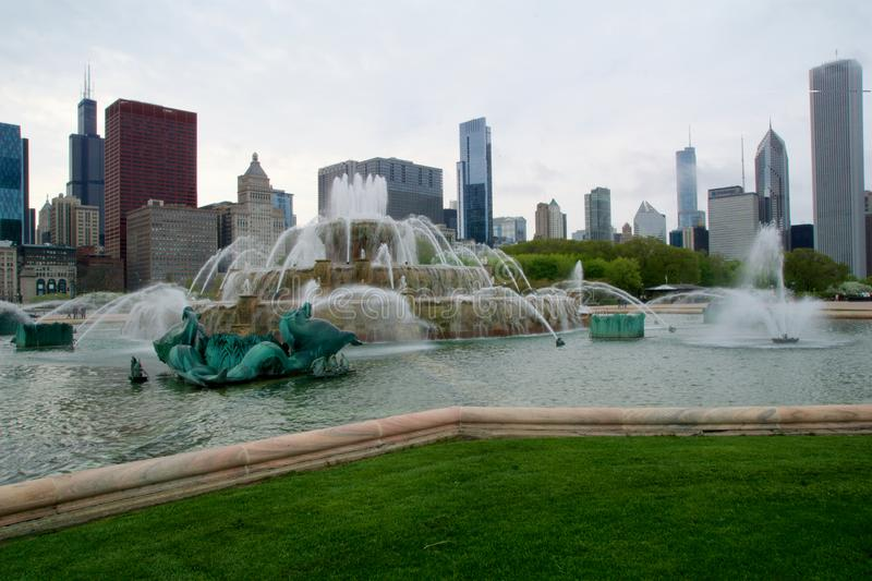 CHICAGO, ILLINOIS, UNITED STATES - MAY 11th, 2018: Buckingham Fountain is one of the largest in the world, in the windy. City`s Grant Park on a beautiful spring royalty free stock photo