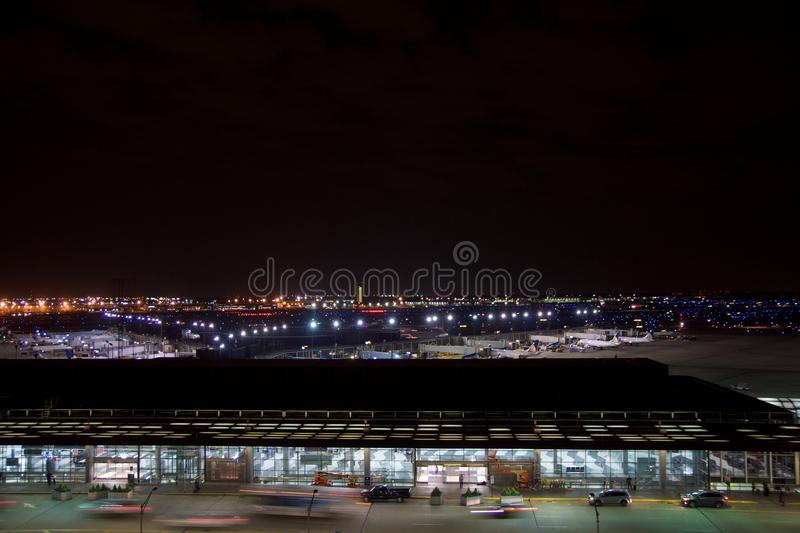 CHICAGO, ILLINOIS, UNITED STATES - MAY 11th, 2018: Outside of Chicago O`Hare International Airport at night with some royalty free stock photography