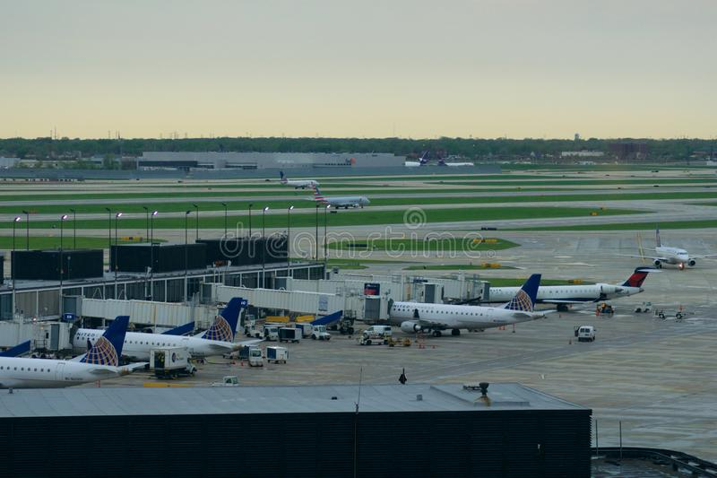 CHICAGO, ILLINOIS, UNITED STATES - MAY 11th, 2018: Several airplanes at the gate at Chicago O`Hare International Airport. In the early morning royalty free stock image