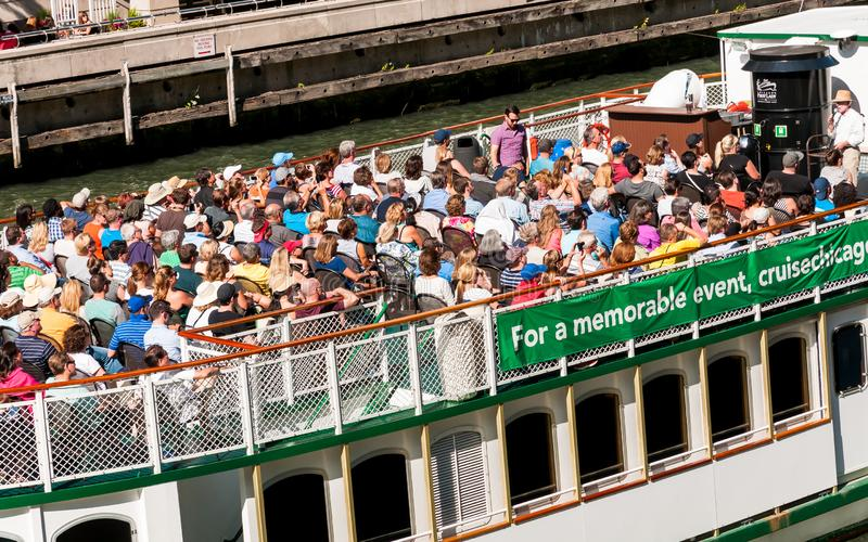 Tourists on Chicago river cruise boat tour traveling towards Lake Michigan. royalty free stock photos