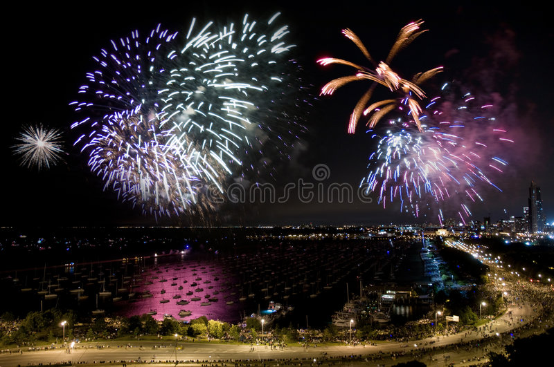Chicago Independence Day Fireworks. Night time aerial view of downtown Chicago lakefront during independence day fireworks stock photo