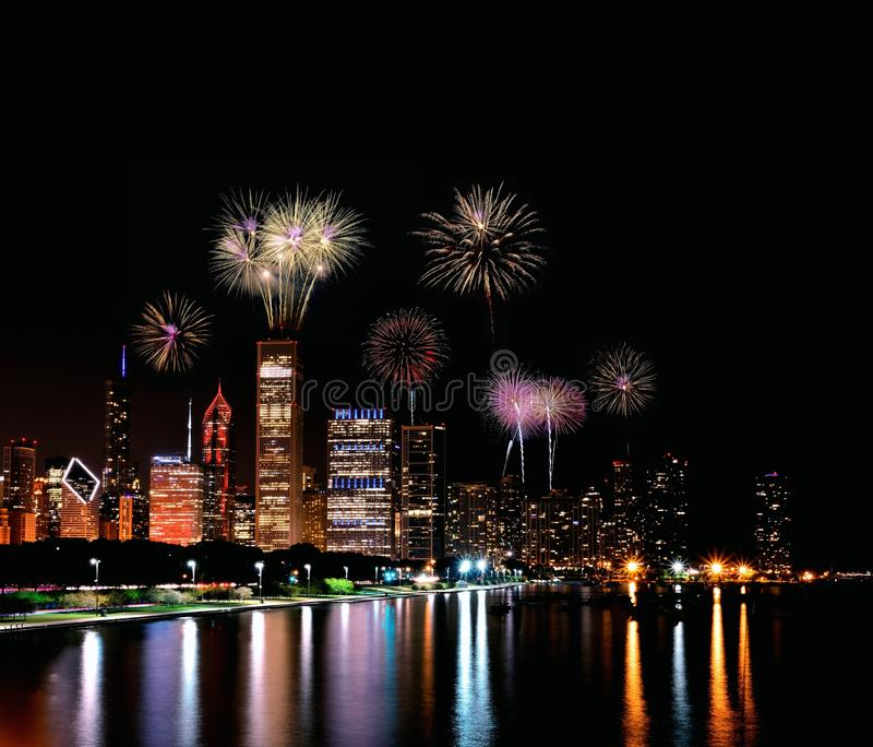 Chicago night skyline with fireworks, Usa. Chicago night skyline across Lake Michigan with fireworks stock image