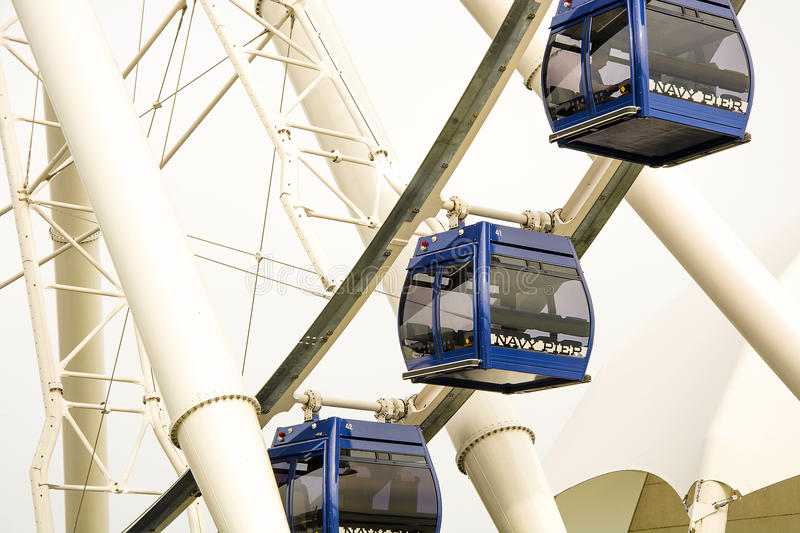 Chicago panoramic Wheel. Chicago, IL, USA, october 28, 2016: Gondolas move passengers of the newly opened Dutch Ferris Wheel in near east side by Navy Pier royalty free stock photo