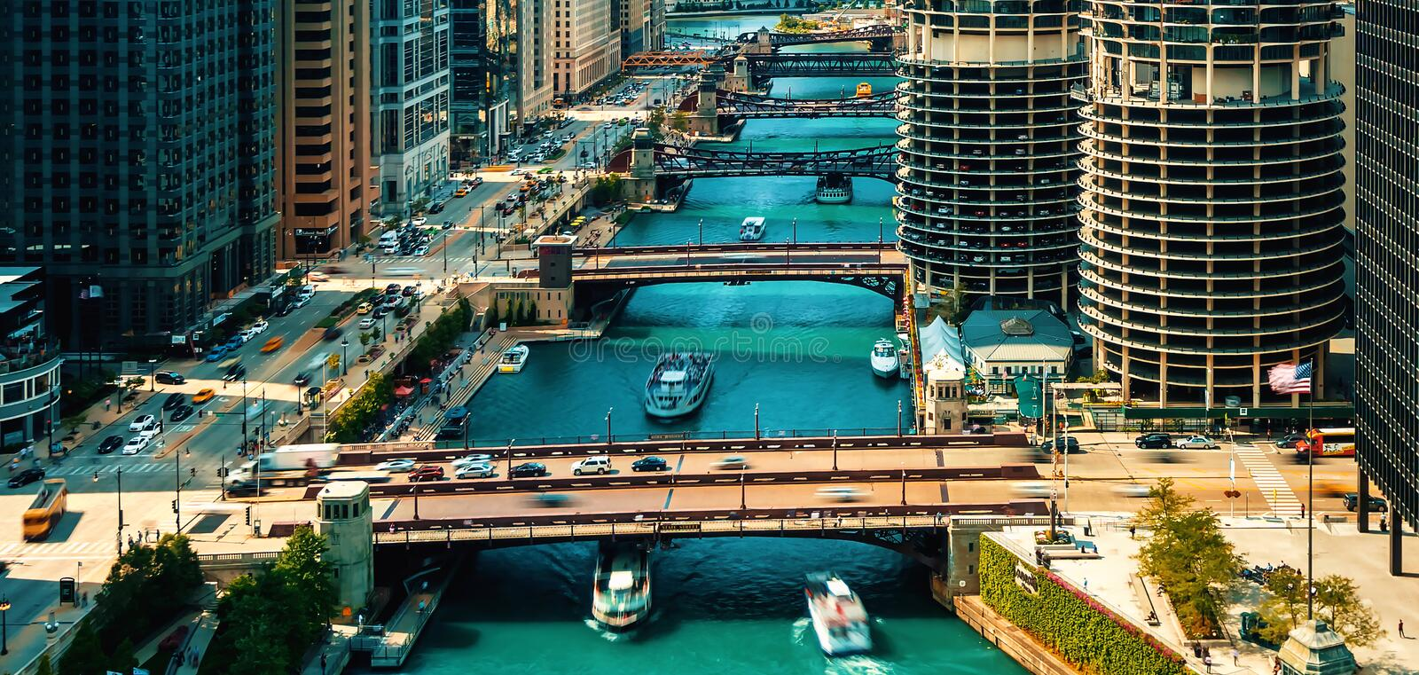 Chicago River with boats from above. Chicago River with boats and traffic from above in the morning stock image