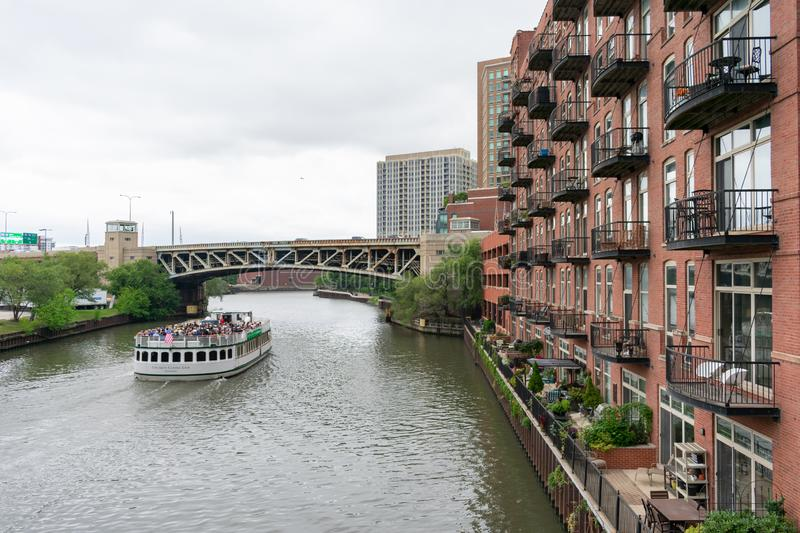 The Chicago River seen from the Grand Avenue Bridge with a Boat Tour and Residential Building stock image