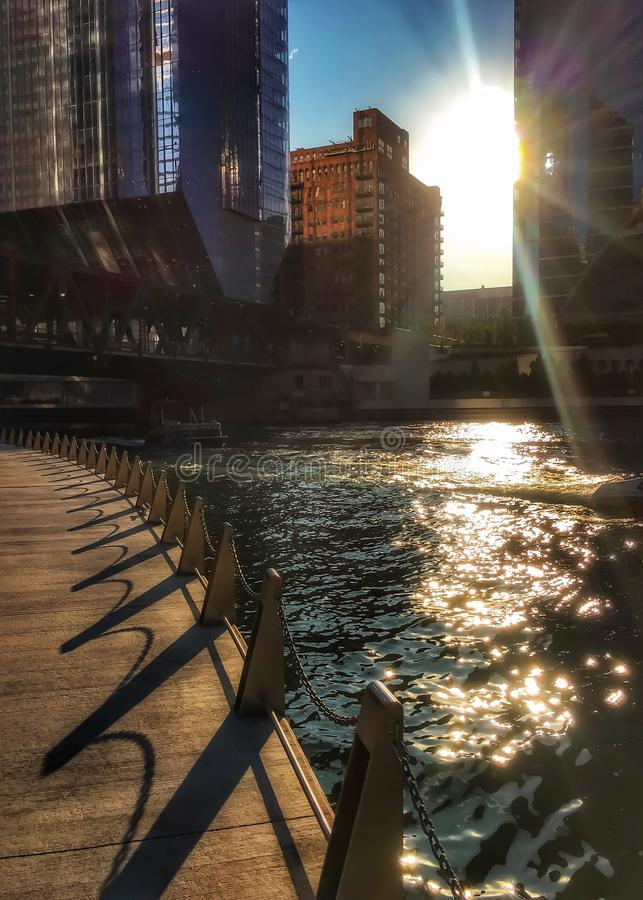 Chicago riverwalk as the sun begins to set, casting shadows royalty free stock photography