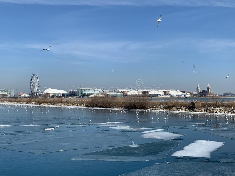 Chicago is about to thaw the lake, white ice blue sky stock photos