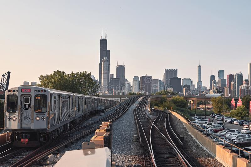 Chicago skyline, cityscape. Train in motion on railway. Taken from chinatown downtown stock image