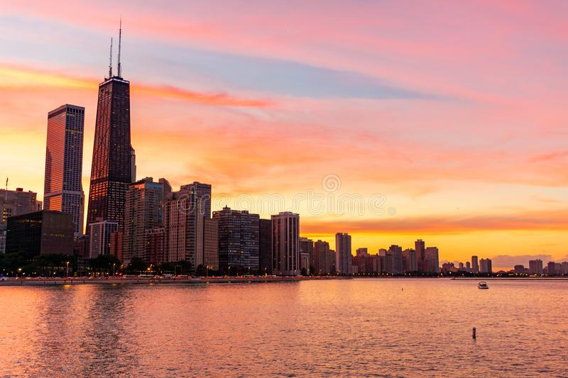 Chicago Skyline during a Colorful Sunset. A Chicago skyline scene and Lake Michigan during a colorful sunset royalty free stock image