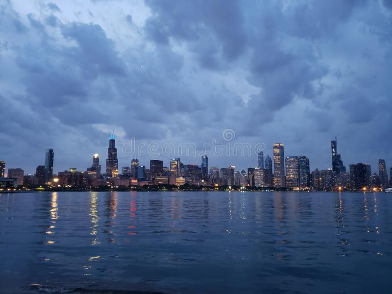 Chicago skyline at night from lake Michigan stock image