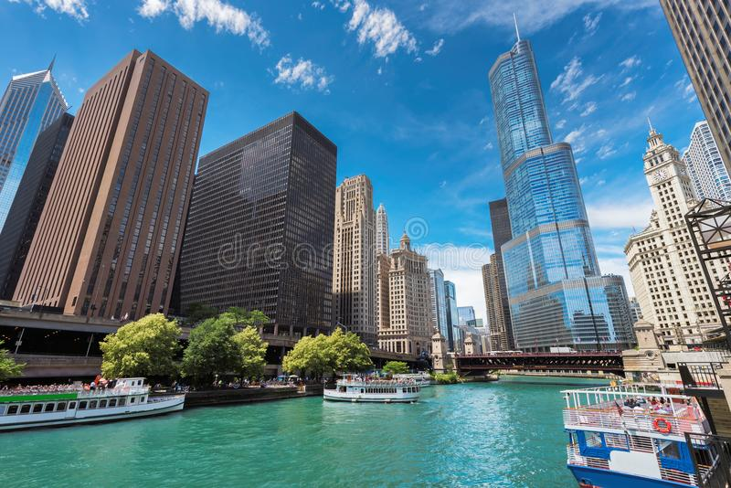 Chicago Skyline, skyscraper and river at sunny day. Beautiful Chicago river and Chicago Downtown with tourist ships at sunny day royalty free stock image