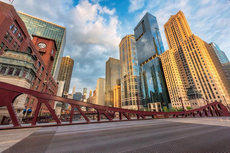 Chicago skyline at sunset. Chicago downtown and Chicago River with bridges during sunset royalty free stock image