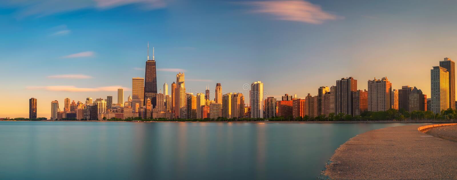 Chicago skyline at sunset viewed from North Avenue Beach royalty free stock images