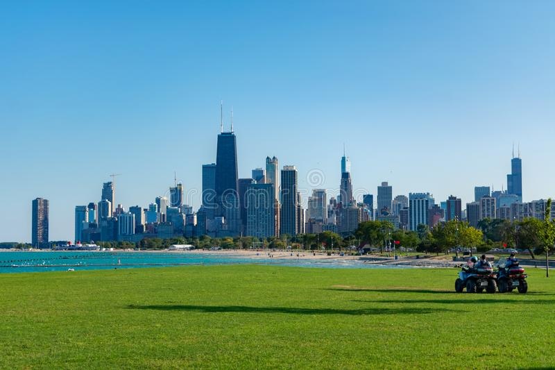 Chicago Skyline with Two Police Officers on All Terrain Vehicles royalty free stock images