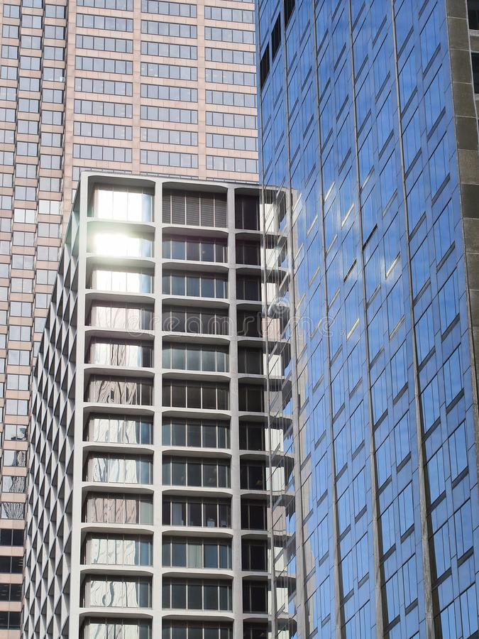 Chicago Skyscraper Architecture, Geometric Patterns and Reflections. Modern skyscraper architecture, Chicago Illinois, with dull mottled blue winter sky royalty free stock photo