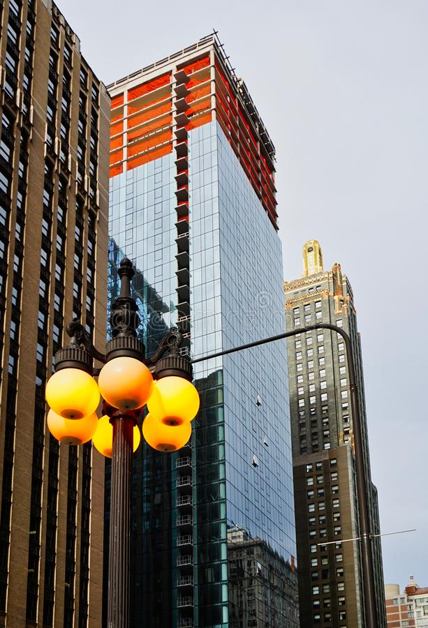 Chicago Skyscrapers and Lit Street Lights. Modern architecture, Chicago skyscrapers or towers on an overcast day with lit street lights. Chicago Illinois, USA stock images