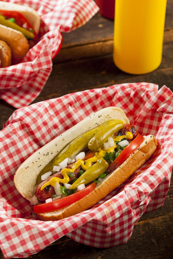 Chicago Style Hot Dog. With Mustard, Pickle, Tomato, Relish and Onion stock photo
