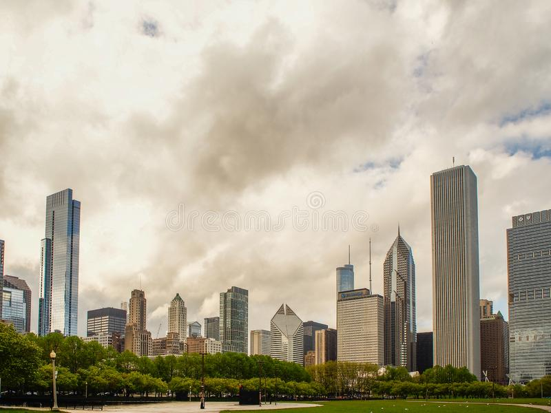 Chicago, United States -  Chicago buildings adn Millennium Park, Chicago city, USA. Chicago, United States - May 11, 2015 -  Chicago buildings and Millennium royalty free stock photography