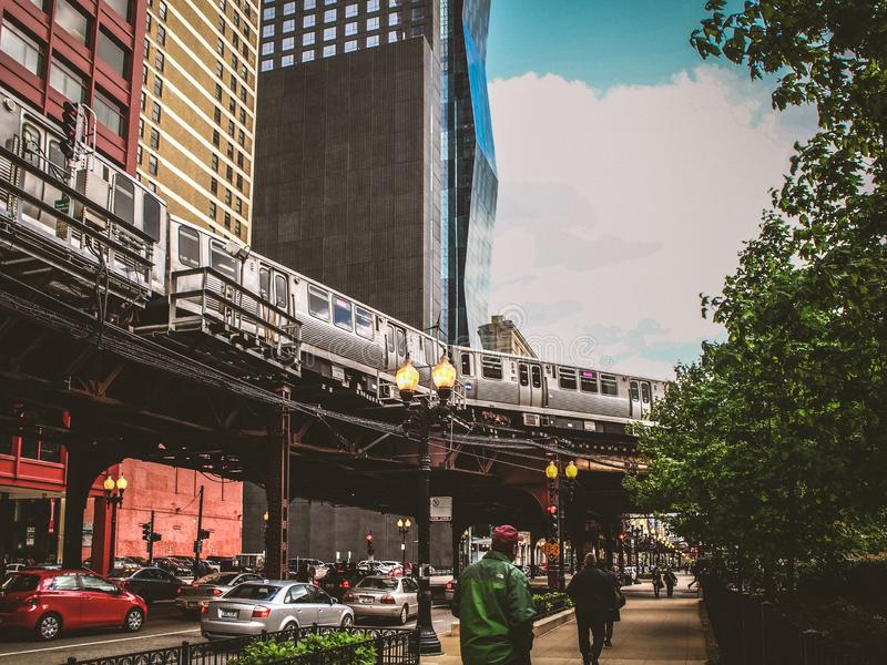 Chicago, United States  Elevated train in the street in Chicago. Chicago, United States - May 12, 2015 - Elevated train in the street in Chicago stock photos
