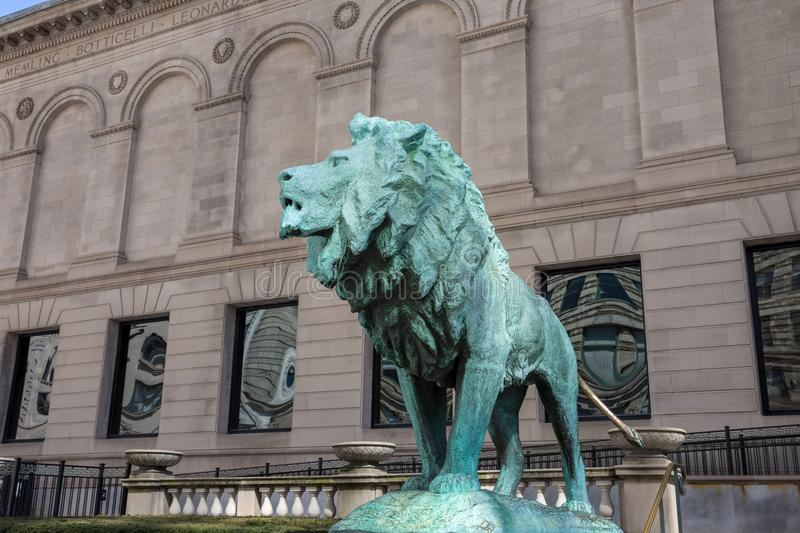 Bronze Lion Statue at the Art Institute of Chicago. Chicago, USA - April 7, 2018: Bronze lion statue standing guard at the Art Institute of Chicago. There are royalty free stock photography