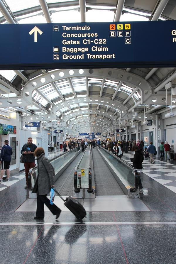 CHICAGO, USA - APRIL 15, 2014: Travelers walk to gates at Chicago O 'Hare International Airport in USA. It was the 5th busiest stock photography