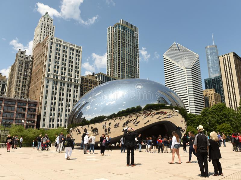 Chicago, USA - June 05, 2018: People near the Cloud Gate, a public sculpture by Anish Kapoor at Millennium Park. Cloud Gate, also royalty free stock images