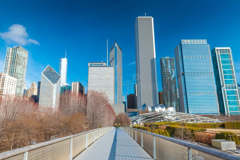 Chicago, USA: View of skyscrapers and office buildings in downtown Chicago. Nichols Bridgeway in Millennium Park stock photos