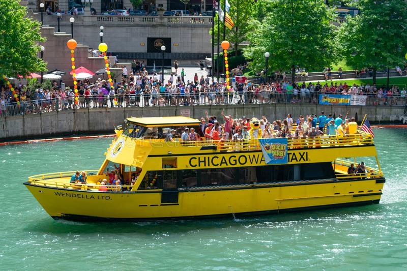 Chicago Water Taxi on the Chicago River during the Ducky Derby Race for the Special Olympics royalty free stock image