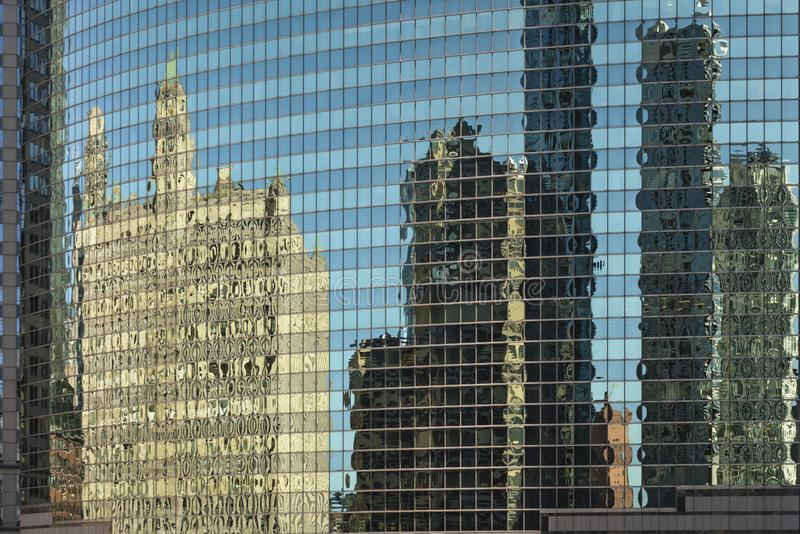 Chicago in a window. Distorted view of Chicago downtown modern and vintage architecture reflected in a mirror facade of a skyscraper stock photos