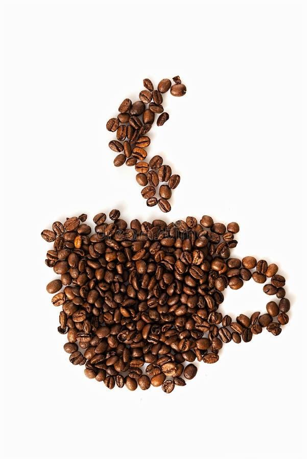 Chicchi di caffè conventionalized alla tazza fotografie stock