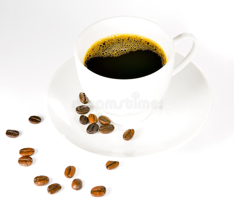 Chicchi di caffè e tazza di caffè fotografia stock