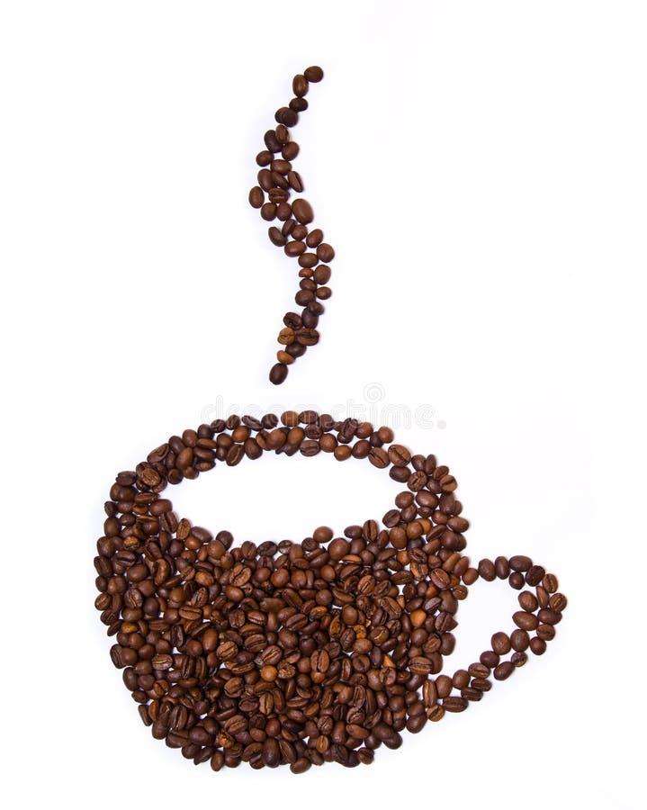 Chicchi di caffè a forma di della tazza fotografie stock libere da diritti